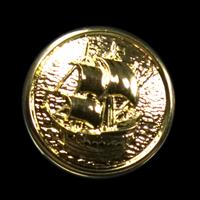 Goldfarbener Knopf mit Segelschiff