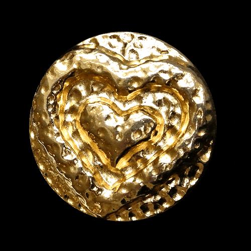 Herziger glänzend goldfarbener Metallknopf mit Öse