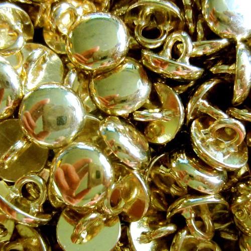 10 kleine goldfarbene Hemden- o. Blusenknöpfe
