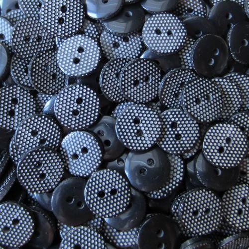 Kleiner schwarzer Blusen Knopf mit weißen Punkten