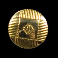 Goldener Metallknopf mit abstraktem Muster